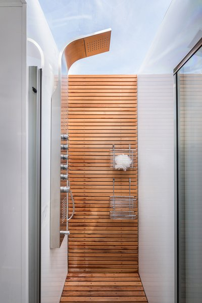 In the bathroom, a skylight above the shower welcomes in natural light.