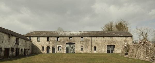 With its courtyard and walled garden, the abandoned structure was once part of a larger Irish estate that included an early 19th-century home.