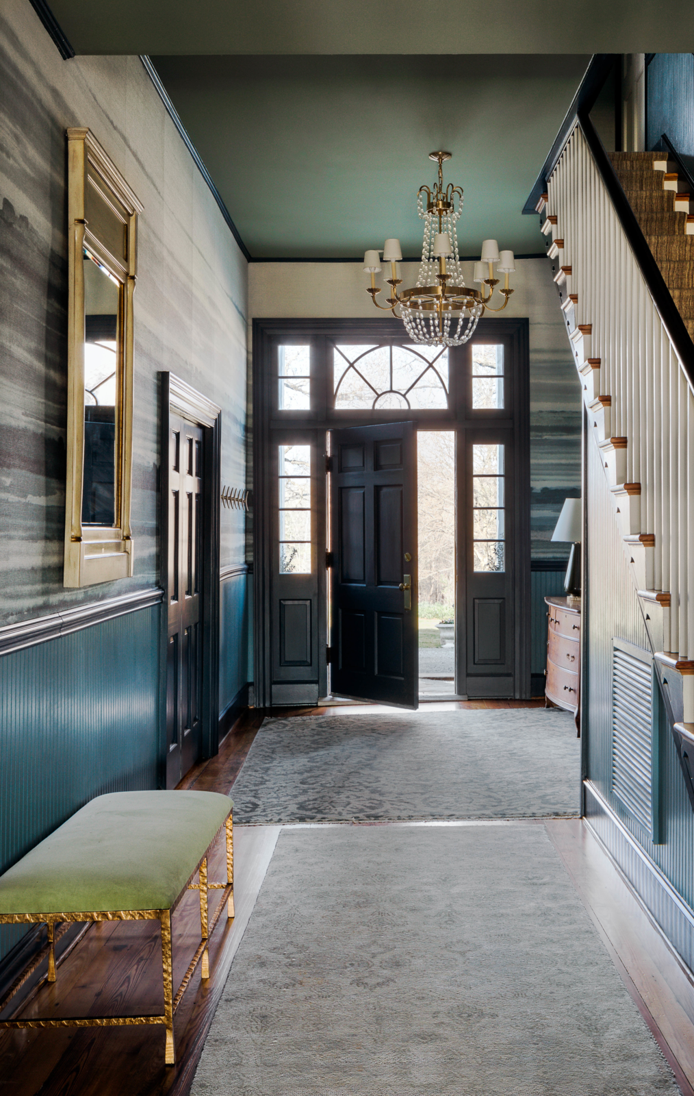 Modern home with Hallway, Medium Hardwood Floor, and Rug Floor. The walls throughout The Clifton were painted in Farrow & Ball's Stone Blue, and the trim was gussied up with the complementary shade of Stiffkey Blue by Farrow & Ball. Photo 2 of The Clifton
