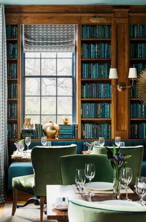 In the Library, built-in bookcases and a long banquette (upholstered in Kravet's Versailles Velvet fabric, color E25600) were installed on the far side of the room.