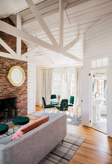 Inside, large windows and vaulted ceilings create a bright and cheery atmosphere.