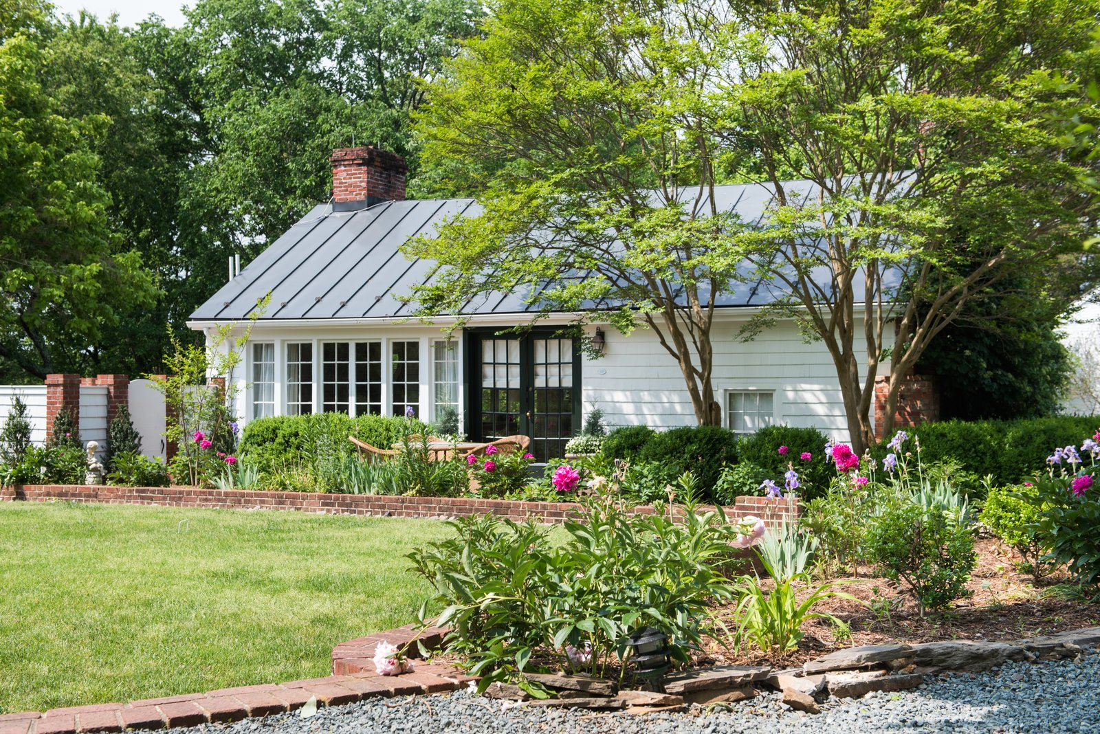 Exterior, Metal, Wood, Small Home, Gable, and House The original carriage house was transformed into a bridal suite that now has three guest rooms.  Best Exterior Metal Wood Small Home Photos from An 18th-Century Virginian Hotel Boasts an Elegant New Look