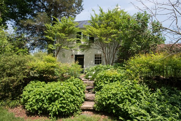 The neighboring garden cottage originally was Randolph's law office. This space shares a garden with the old carriage house.
