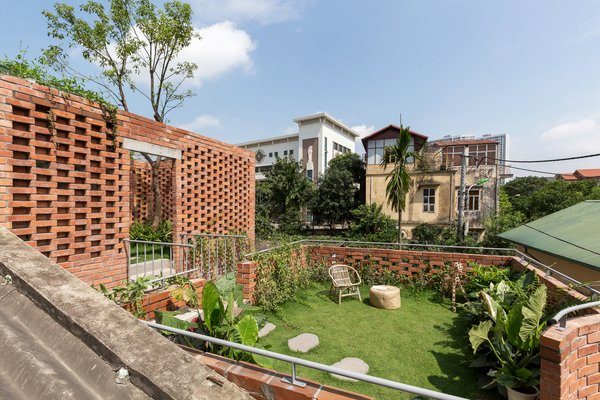 On the second story, a rooftop garden spans the top of the house, offering views of Vietnam's capital city.