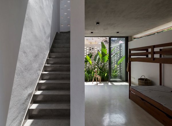 A staircase leads from the bedroom to the rooftop garden.