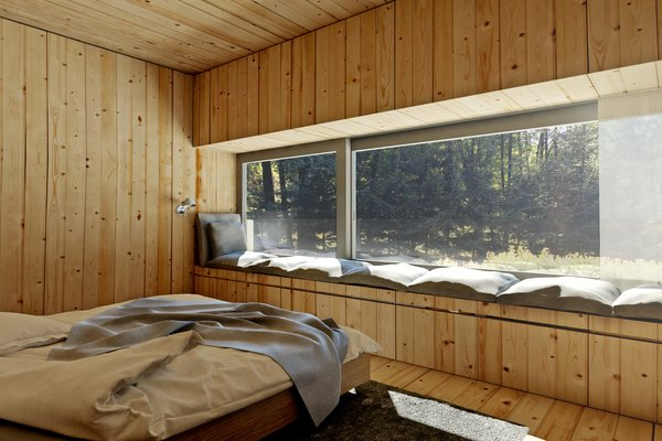 Built-in window seats in the bedrooms provide perches to view the cabin's natural surroundings.
