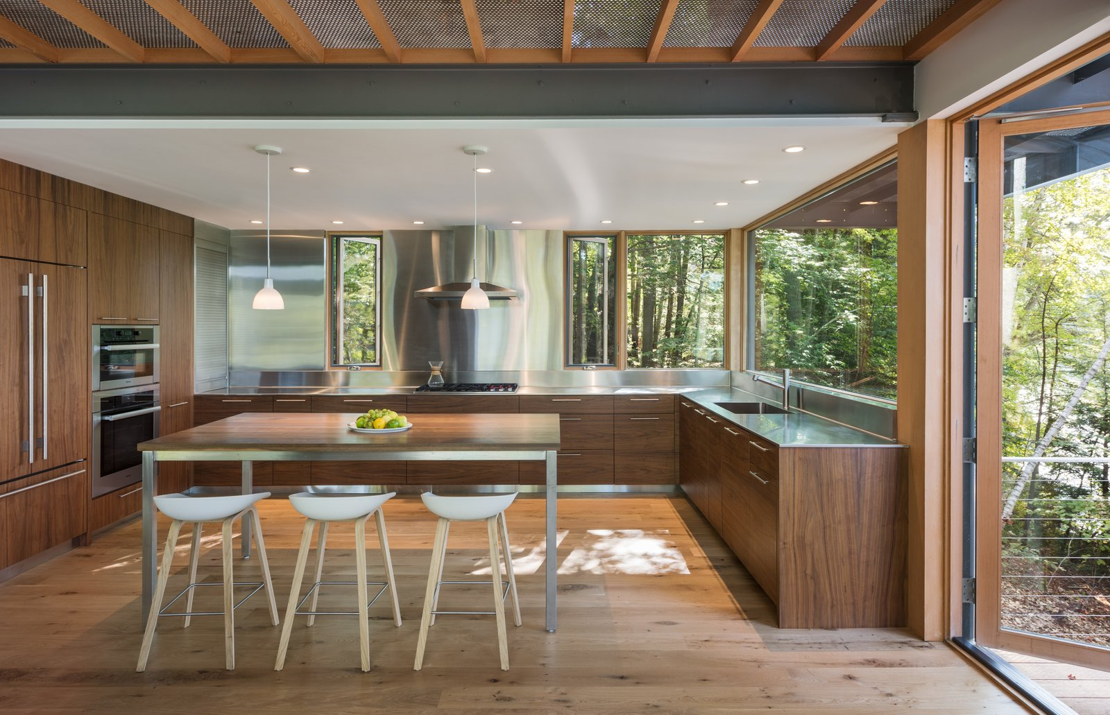 Modern Cabin walnut and stainless-steel kitchen
