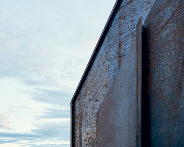 A tough, rusted steel exterior holds up against the elements of a construction site.