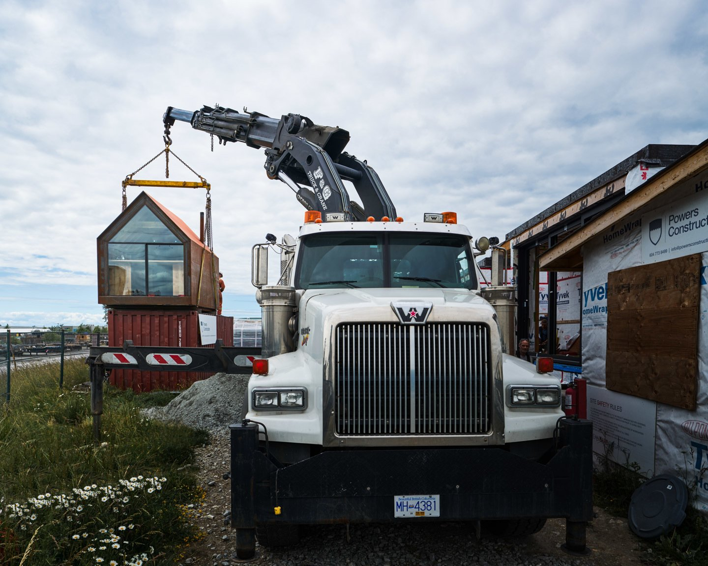 Site Shack being hoisted by crane for transport
