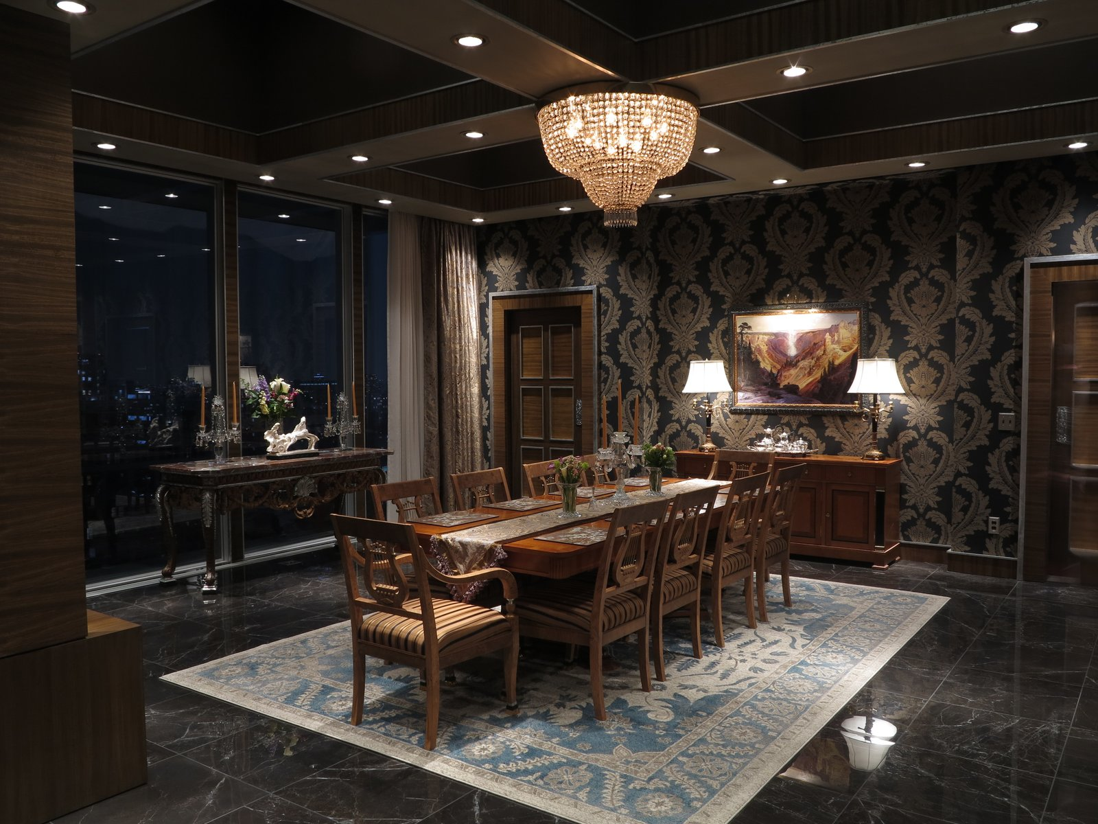 """""""I just love the black and gold wallpaper in the dining room,"""" says Bougton. """"It goes well with the Biedermeier pieces and is very Napoleonic and very powerful. It's a big aggressive Germanic pattern and statement.""""  Photo 6 of 9 in Behind the Scenes: A Dystopian, Midcentury Penthouse in 'The Man in the High Castle'"""