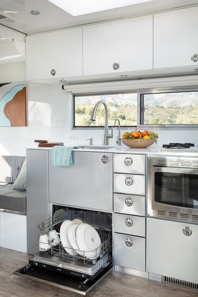 The 2020 model's kitchen includes all the comforts of home with a dishwasher, pull-out microwave, large refrigerator, and oven and stove combo.