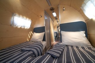 A cozy sleeping berth with two single beds is found at the front of the trailer.