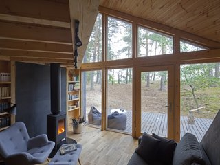 The windows, which tower over 16 feet, provide plenty of natural light for the cabin.