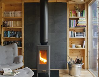 The Iwaki cast-iron wood stove by Invicta keeps the space warm during Poland's cold winters.