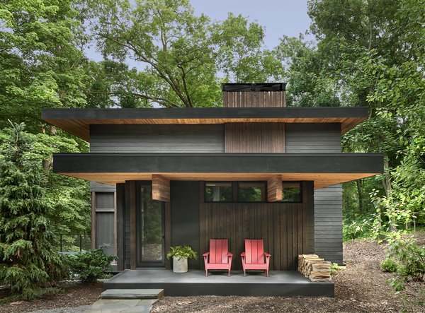 """""""The ceiling plane starts with giant beams as you step up on the front porch, and they run at the same level throughout the axis of the house,"""" says Lamaster. """"As you step down into the home, they accentuate the feeling of moving down the hill. We wanted to create that intimate, low feeling when you walk in."""""""