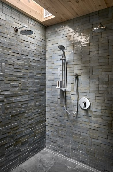 The clay tiles in the master suite's shower were cut and fired by hand. The natural, textured tiles vary in color, and they were fired with a high-gloss finish, giving the shower the appearance of a shimmering cave.