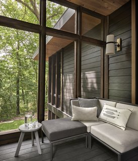 A large screened porch makes alfresco entertaining easy.