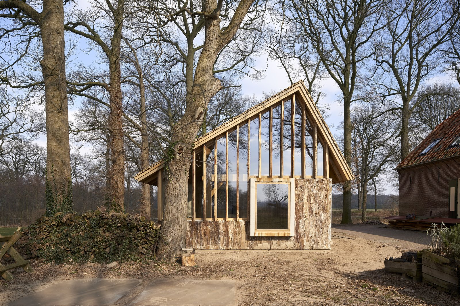 The barn makes extraordinarily efficient use of timber milled from on-site trees.