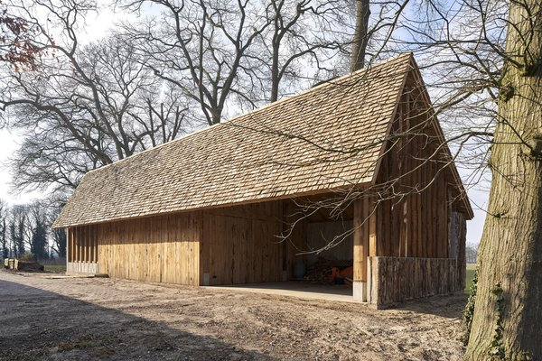 The strong structural members and facade planks are made from tree trunks.