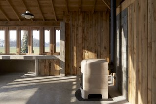 A Deklein & Vanhoff wood stove keeps the workspace toasty during the Netherlands' cold winters.