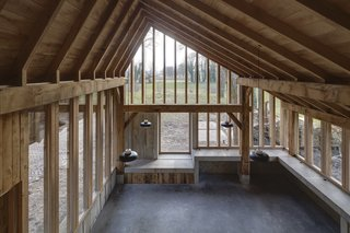A minimal palette of materials—oak, concrete and glass—allows the unique design of the barn to shine.