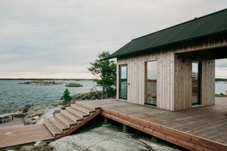 Large outdoor entertaining spaces allow the designers to enjoy the long summer days—and a hot tub and a traditional Finnish sauna make the chilly evenings cozy and fun.