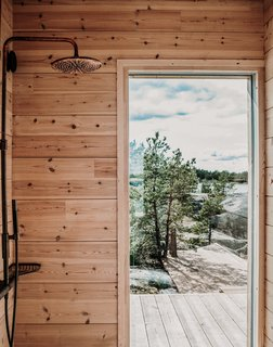 On the other end of the house, a separate structure houses a sauna, shower, and toilet.