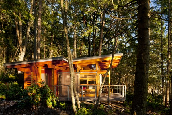 The sloped metal roofs were designed to capture rain, which is used in the cabins.