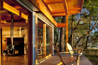 Glass sliders lead to a 200-square-foot cedar deck that overlooks the Straight of Georgia.