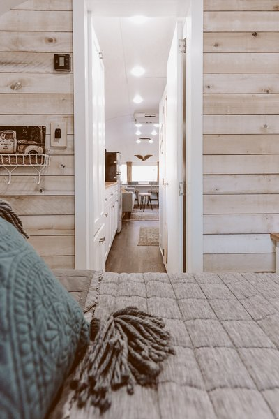 The faux-shiplap look continues into the sleeping quarters.