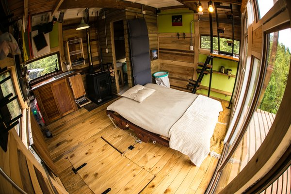 The main living space includes a futon and kitchen area, with a washroom tucked in the corner.