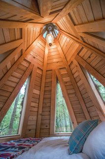 The 65-square-foot sleeping loft has just enough room for a bed.