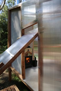 A unique door that swivels from the top was designed to prevent heat escape.