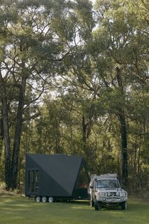 The Base Cabin can be towed by a SUV or pickup truck, and its angular frame makes it more aerodynamic than traditional tiny homes.