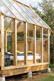 A hatch above the bed gives campers the option of sleeping exposed to the elements or tucking themselves away.