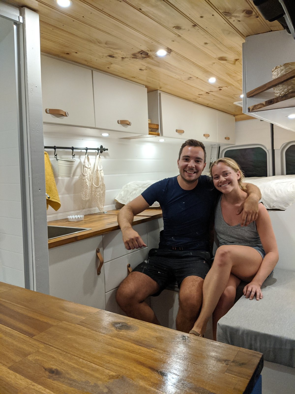 Ben and Georgia Raffi in their renovated campervan