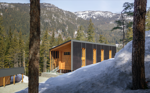 The neighboring building houses a storage room and a wood-burning sauna.