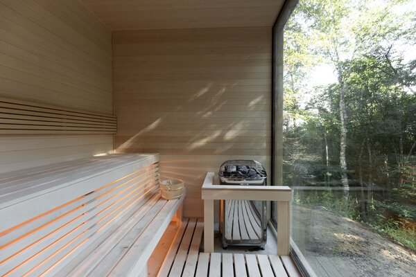 The sauna is framed by a large floor-to-ceiling window, so guests can enjoy views of the great outdoors.