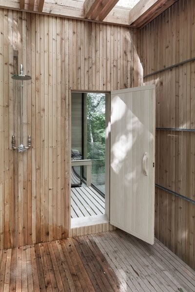 An outdoor cold shower is located on the deck adjacent to the sauna.
