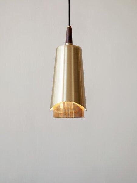 Arthur Umanoff originally designed his brass-and-walnut pendant light for Mobilite.