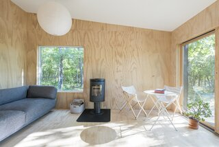 A simple palette of pine plywood walls and white-washed pine floors give's the cabin a minimalist yet warm feel.