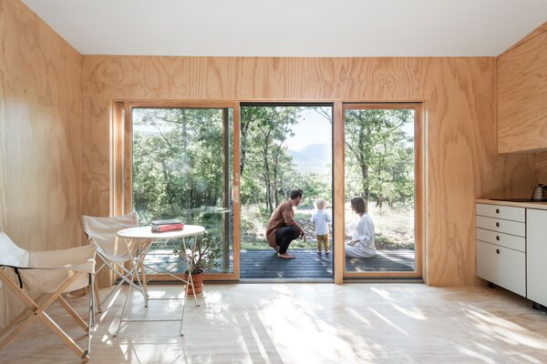The family of three (soon to be four) uses the minimalist-inspired cabin in the Catskills as their peaceful weekend getaway. In the future they hope to build a larger home and turn the cabin into a guest house.