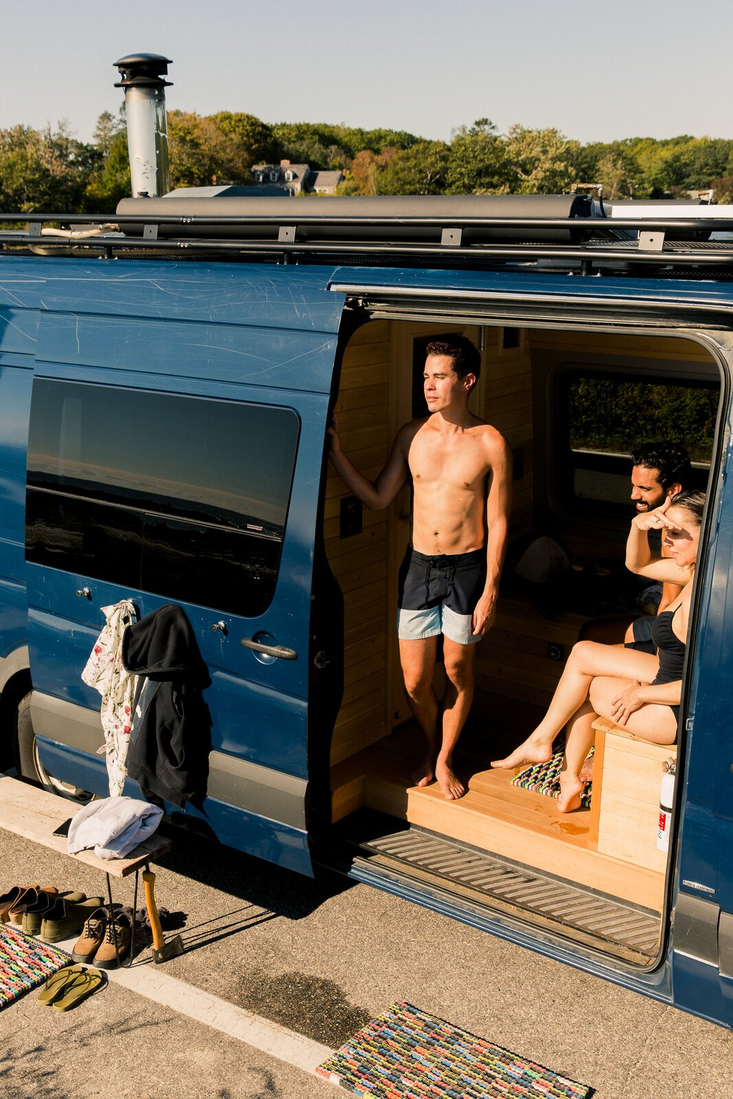 In the front of the van, a seating area with under-bench storage provides a place for bathers to relax.  Photo 4 of 11 in Missing the Spa? This Converted Mercedes Sprinter Can Bring the Sauna to Your Doorstep