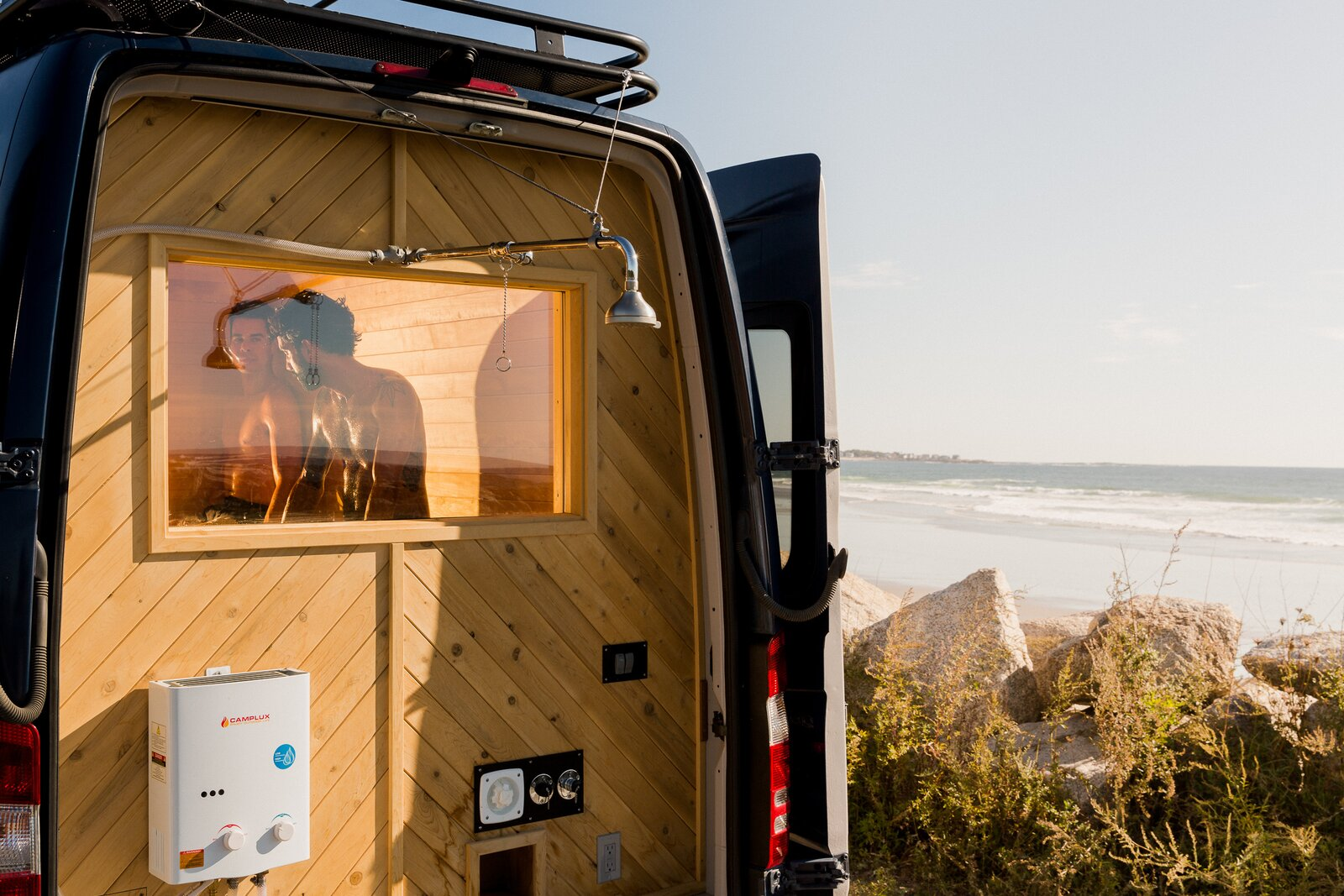 The outdoor shower wall is glad in Eastern white cedar and Douglas fir.  Photo 8 of 11 in Missing the Spa? This Converted Mercedes Sprinter Can Bring the Sauna to Your Doorstep