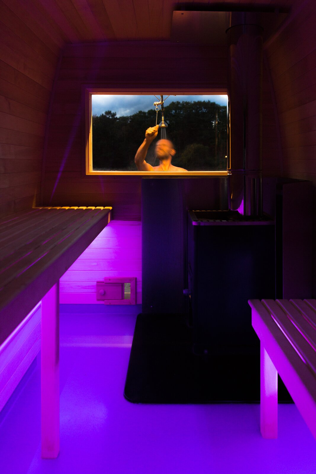 Underbench LED strips create ambient mood lighting.  Photo 10 of 11 in Missing the Spa? This Converted Mercedes Sprinter Can Bring the Sauna to Your Doorstep