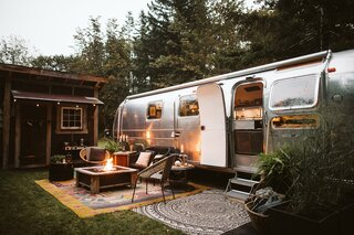 Rather than include the bathroom in the trailer, the family decided to set it in an outhouse, giving them more living space in the Airstream.