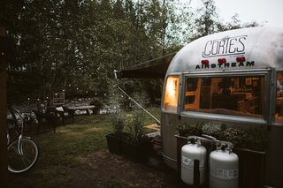 Instead of polishing the exterior, they decided to embrace the old Airstream's aged patina.