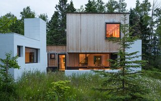 A sleek private residence on Lake Superior has a neighboring sauna with great views.