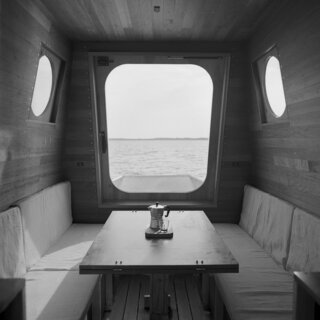 """""""The benches on the two sides of the dining table hide roomy containers that are accessible during the night as well,"""" Bene says. """"There are other storage spaces in the boat—for example, the prow is accessible from inside, and it gives us extra room to store equipment."""""""