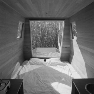 The dining table folds down into a double bed.